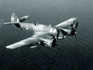 A Bristol Beaufighter flying over the sea in a patrol mission.