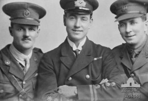 The ace Roderic Dallas, in the center, with two RNAS officers.