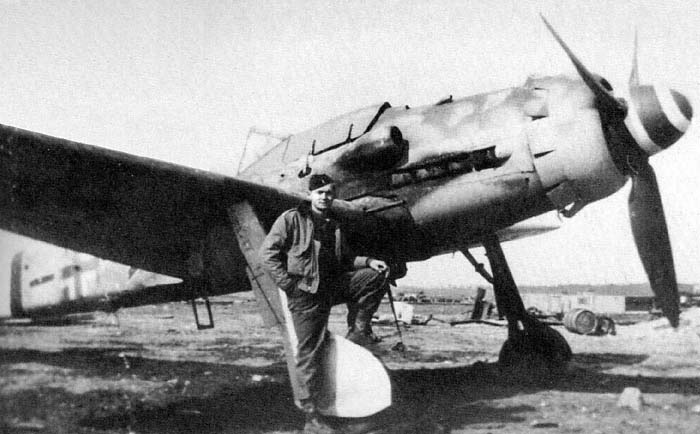 A German pilot posing close to his FW-190D.