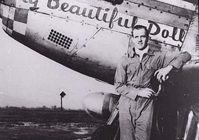 Jonh Landers and his aircraft with all his victories marked on the fuselage!