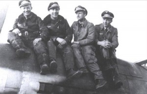 Hauptmann Wübke (the second from left to right) with other pilots sitting on Red 3.