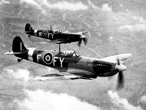 Two Spitfire Mk IX of No. 611 Squadron in flight.