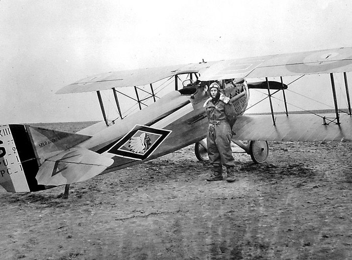 Robert Soubiran and his aircraft on a airfield.