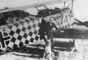 Sachsenberg with his yellow and black chequered Fokker D.VII at Jabbeke airfield.