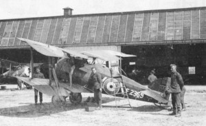 A Snipe in maintenance, with the mechanics working on the aircraft.