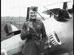 A smiling Rickenbacker, close to his airplane.