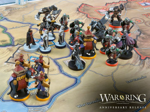 War of the Ring Anniversary Release: production miniatures on the Second Edition board.