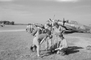Pilots of No. 135 Squadron RAF at Chittagong, India, near the P-47 HB975 WK-L.