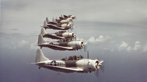 A formation of SBD-5 Dauntless from Marine Scouting Squadron 3 (VMS-3) in flight near the Virgin Islands.